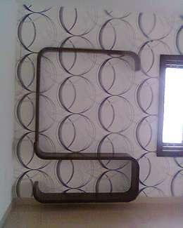 Wallpapers at 8Streaks Hyderabad: modern Living room by Eight Streaks Interiors