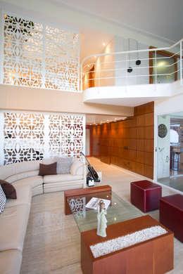 Vivienda 609: Salas / recibidores de estilo moderno por Objetos DAC