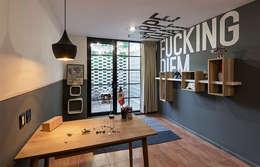 Estudios y oficinas de estilo industrial por MX Taller de Arquitectura & Diseño