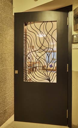 main door: eclectic Living room by iSTUDIO Architecture