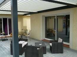 EXTENSION MAISON A: Terrasse de style  par FARACHE CLAUDE