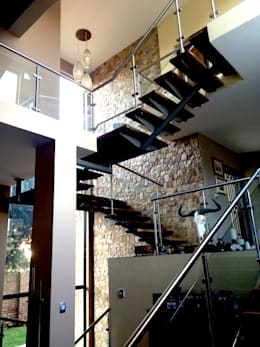 Dining room stairwell: modern Dining room by Nuclei Lifestyle Design