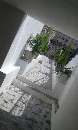 Jardines de estilo ecléctico por Erina Cardoso