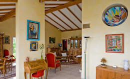 Salas de estilo rural por Pierre Bernard Création