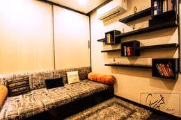 A Duplex Apartment, Raipur: modern Study/office by ES Designs