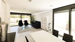 Salas / recibidores de estilo moderno por arqubo arquitectos