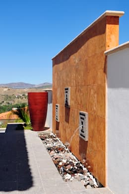 Terrazas de estilo  por Excelencia en Diseño