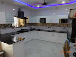 high gloss white hdf material  : modern Kitchen by aashita modular kitchen