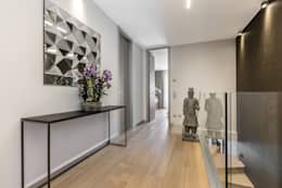 Corredores e halls de entrada  por NG-STUDIO Interior Design