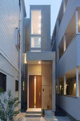 Casas de estilo moderno por 北村大作建築設計事務所