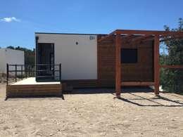 Projekty, minimalistyczne Domy zaprojektowane przez KITUR