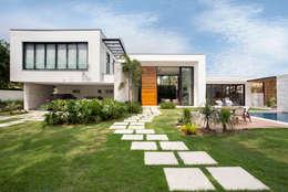 Projekty, nowoczesne Domy zaprojektowane przez Amanda Miranda Arquitetura
