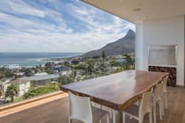 HOUSE  I  ATLANTIC SEABOARD, CAPE TOWN  I  MARVIN FARR ARCHITECTS:  Patios by MARVIN FARR ARCHITECTS