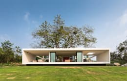 Maisons de style de style Minimaliste par Yucatan Green Design