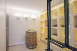 Salas de estilo minimalista por ABAD Y COTONER, S.L.