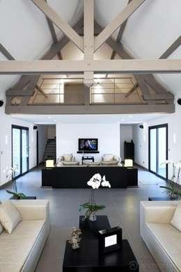 Rénovation d'une maison traditionnelle en maison moderne et luxueuse: Salon de style de style Moderne par Archionline