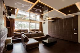 Home Theater:  Multimedia room by A360architects