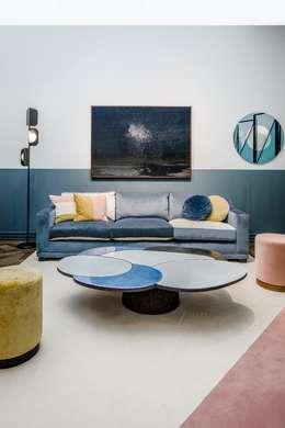 Salas de estilo moderno por M.M. Lampadari