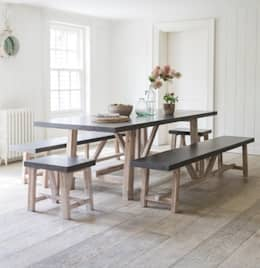 rustic Dining room by Modish Living
