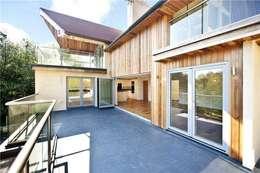 de estilo  por Heritage Designs - Timber Frame Manufacturers