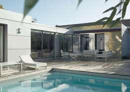 moderne Häuser von YF Aaidg (atelier D'architecture Interieur Et De Design Global