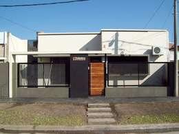 Oficinas y Comercios de estilo  por D'ODORICO OFICINA DE ARQUITECTURA