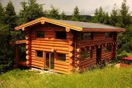 Casas de estilo rústico por Organica Design & Build