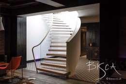 Salas multimedia de estilo ecléctico por Bisca Staircases