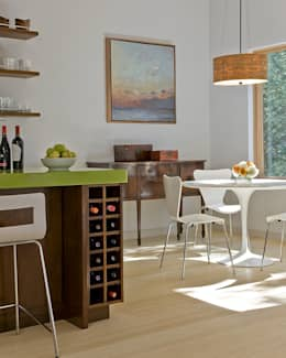 Kitchen wine storage and dining area: modern Dining room by ZeroEnergy Design