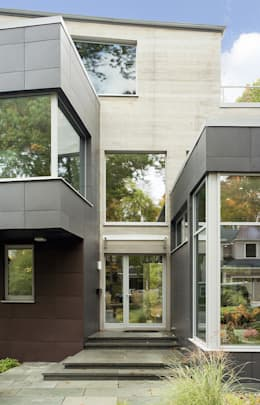 Modern home entry with acrylic awning for weather protection: modern Houses by ZeroEnergy Design