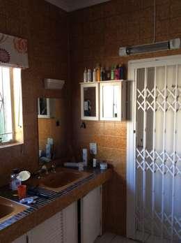 View of vanity before:   by Urban Dwellers Design Studio