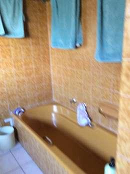 View of bath before:   by Urban Dwellers Design Studio