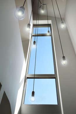 Gang en hal door Marcus Hofbauer Architekt