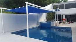 Piscinas de estilo mediterraneo por GAVIOTA MEXICO