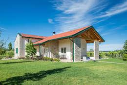 Casas de madera de estilo  por Woodbau Srl
