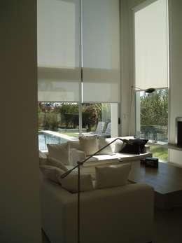 Casa AM Racionalista en Nordelta: Comedores de estilo minimalista por Estudio Medan Arquitectos