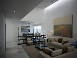Salas de estilo moderno por Ambás Arquitectos