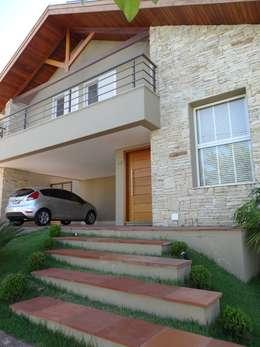 canatelli arquitetura e design: kırsal tarz tarz Evler