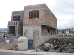de estilo  por Grupo Puente Arquitectos.com