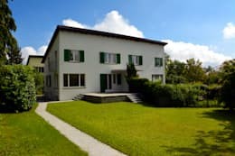 Fassade Südwest: moderne Häuser von Beat Nievergelt GmbH Architekt