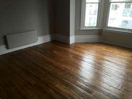 Projekty,  Salon zaprojektowane przez The British Wood Flooring Company