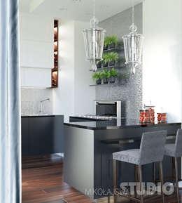 Elegancka kuchnia: styl , w kategorii Kuchnia zaprojektowany przez MIKOŁAJSKAstudio
