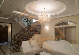 الصاله السفلية :  غرفة المعيشة تنفيذ شركة زمزم للتصميم و التفيذ المعماري