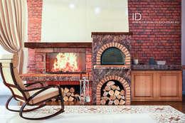Камин и печь – украшение гостиной: Гостиная в . Автор – Студия дизайна Interior Design IDEAS