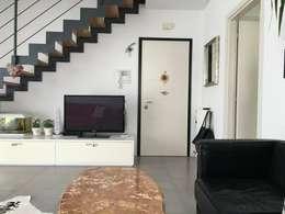 Projekty,  Korytarz, przedpokój zaprojektowane przez Immobiliare De Piccoli