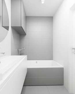 Baños de estilo minimalista por FOORMA Pracownia Architektury Wnętrz