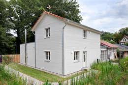 Projekty, klasyczne Domy zaprojektowane przez Müllers Büro