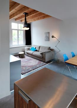 Home renovation: minimalistic Living room by BuroKoek