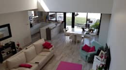 Casa Pellegrini: Livings de estilo moderno por Articular Arquitectura