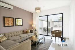 """""""PROYECTO LDZ26"""": Salas de estilo ecléctico por PORTO Arquitectura + Diseño de Interiores"""